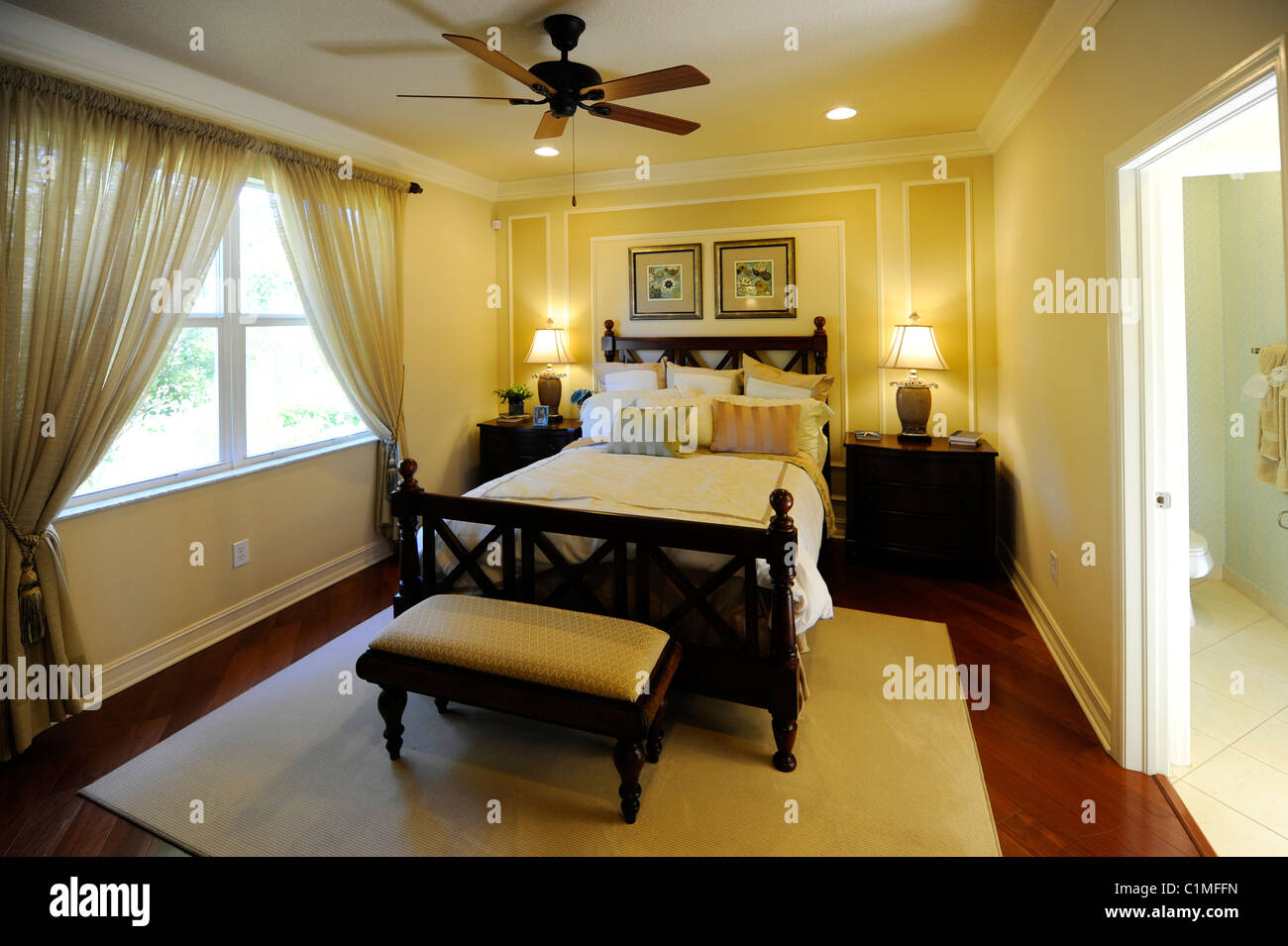 Interior spacious modern bedroom of an upscale new home construction Tampa Florida - Stock Image