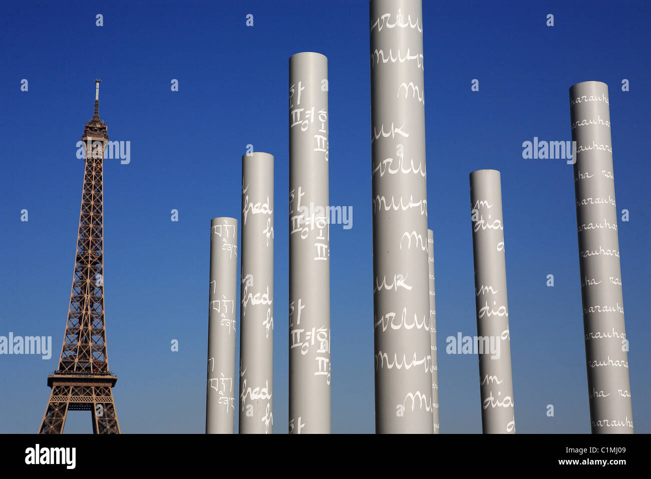 France, Paris, Peace wall by Jean Michel Wilmotte and Clara Halter and the Eiffel Tower in the Champs of Mars - Stock Image