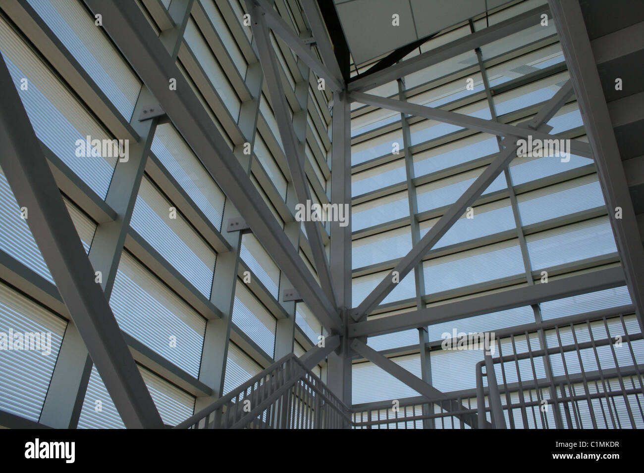Light, air, glass and steel play together in this modern architectural stairwell. Stock Photo