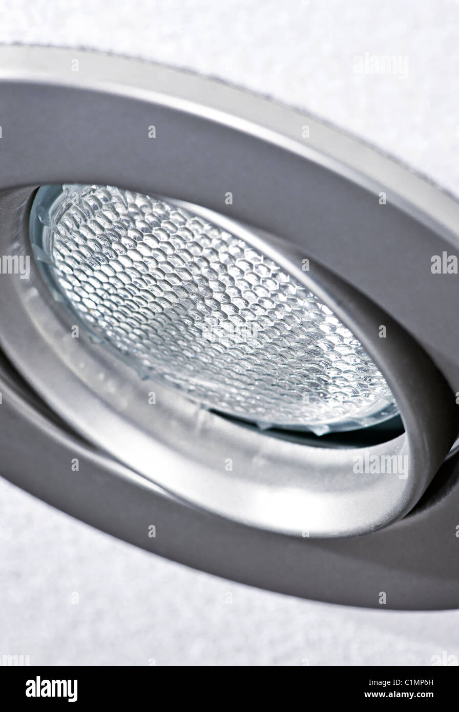 Closeup of pot light recessed lighting in ceiling tile - Stock Image