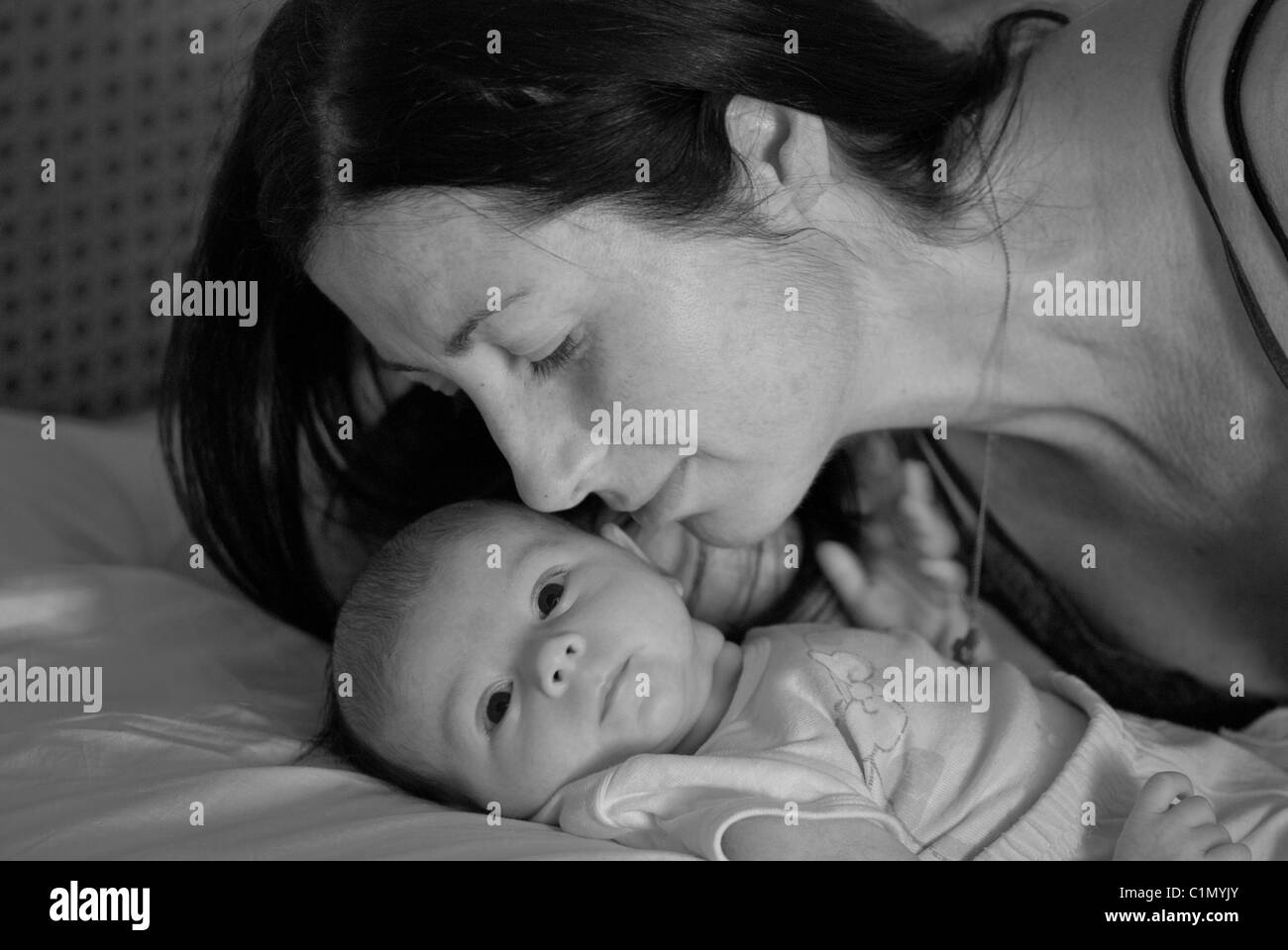 Mother's Love Behavior for her Newborn Daughter - Stock Image