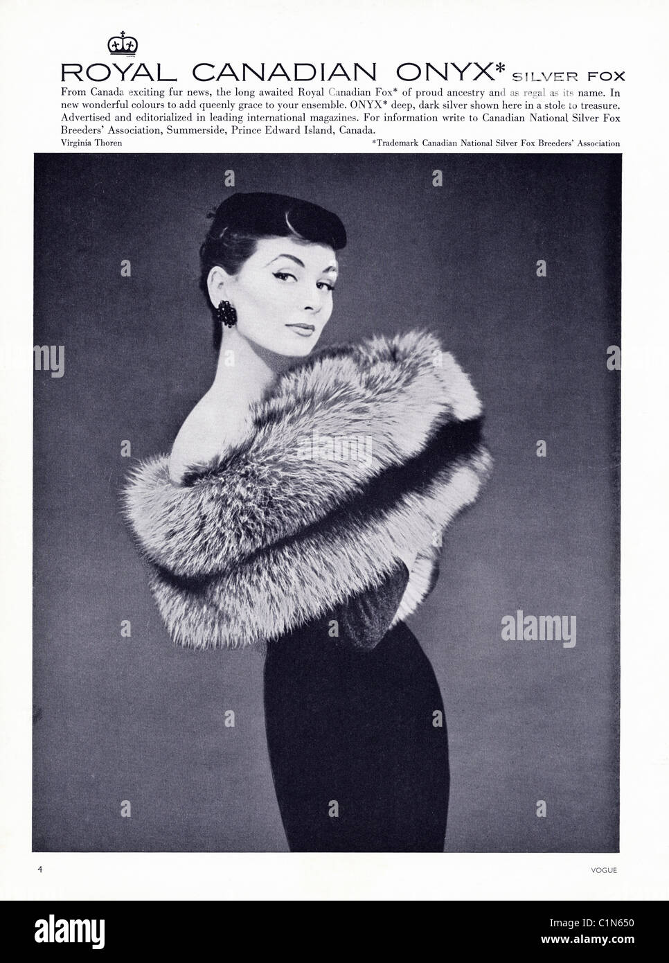 Original full page 1950s advert in women's fashion magazine for ROYAL CANADIAN ONYX SILVER FOX fur - Stock Image