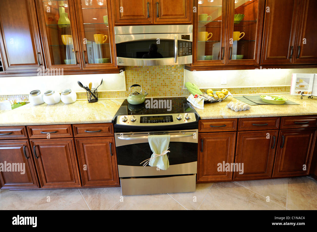 Interior spacious modern dining kitchen room of an upscale new home construction Tampa Florida - Stock Image
