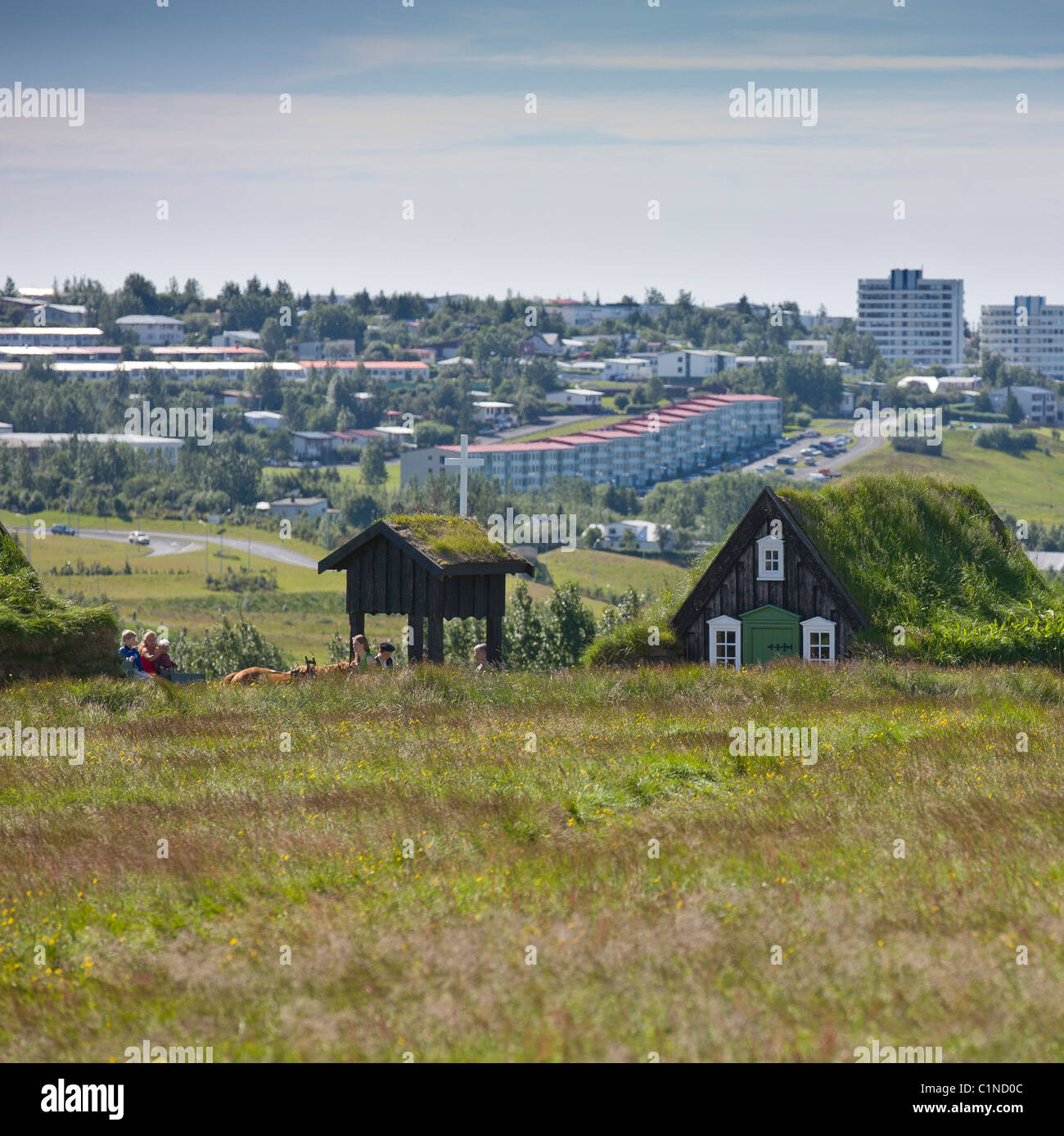 Arbaejarsafn (folk museum) with Reykjavik in background, Iceland - Stock Image