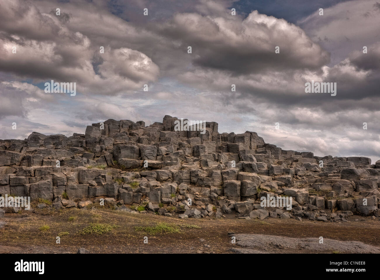 Large basalt volcanic rocks on the road to Dettifoss waterfall, Iceland - Stock Image