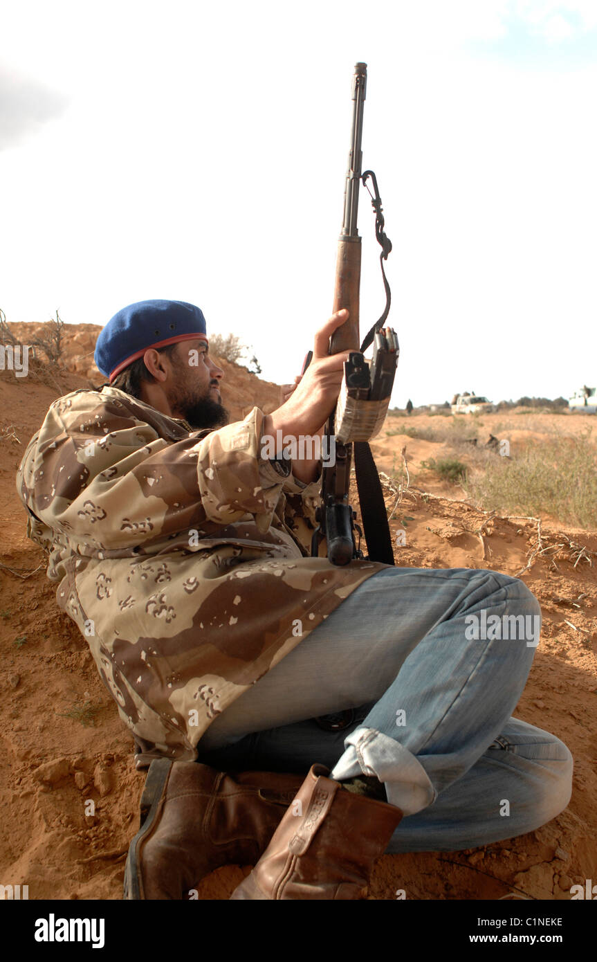 Rebel takes cover during fighting. Ras lanuf Lybia Stock Photo