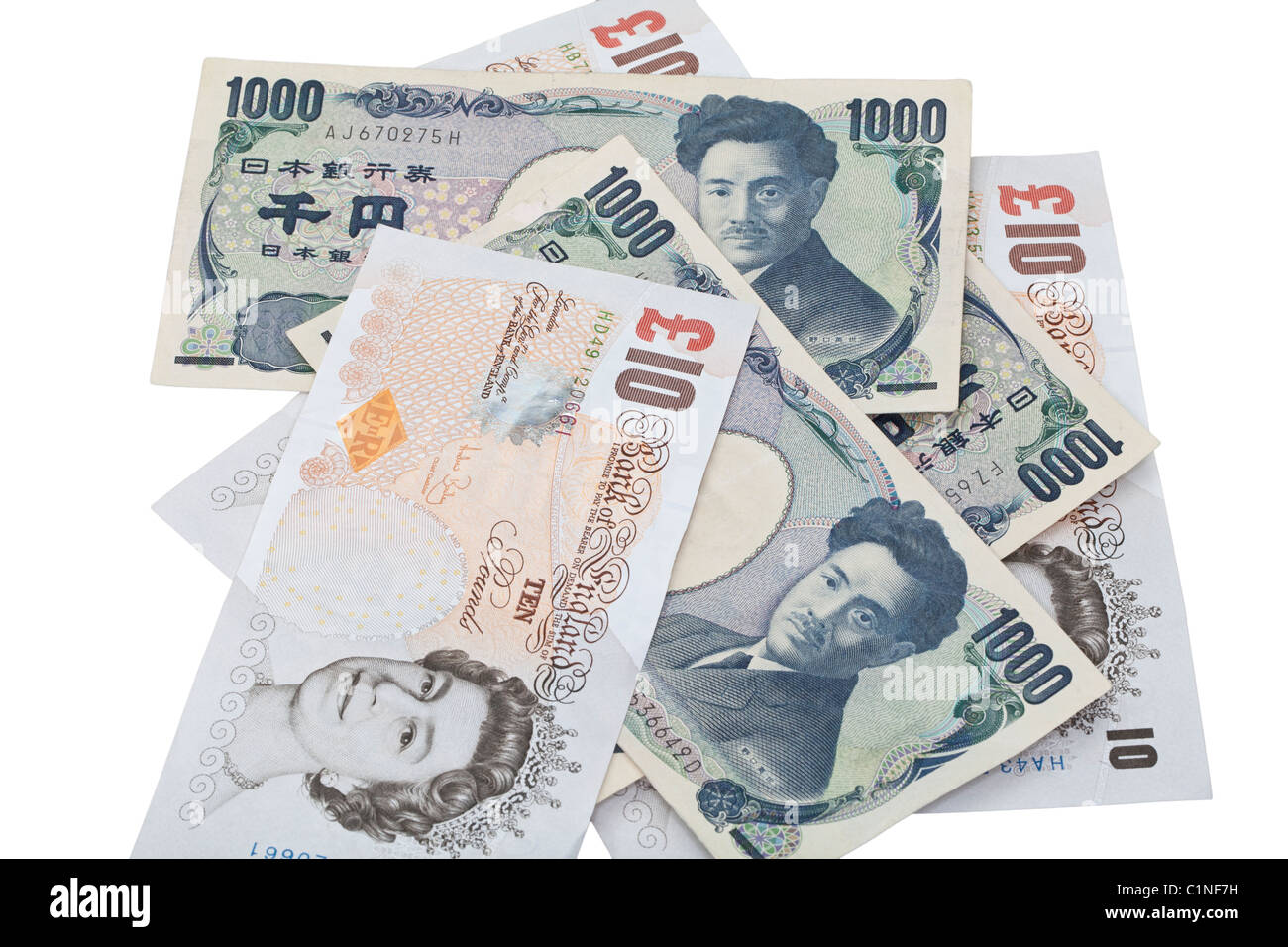 Japanese Yen and British banknotes against a white background - Stock Image