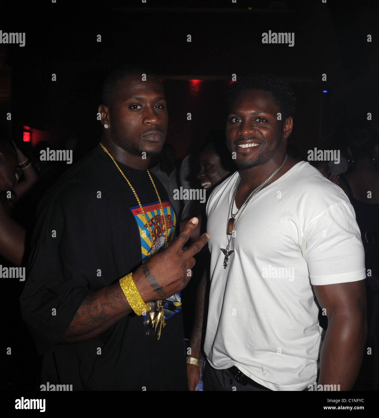 Thomas Jones and Julius Jones during DWoods birthday celebration at