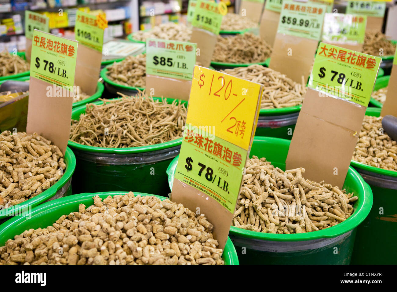 Chinese herbal roots on sale in market. - Stock Image