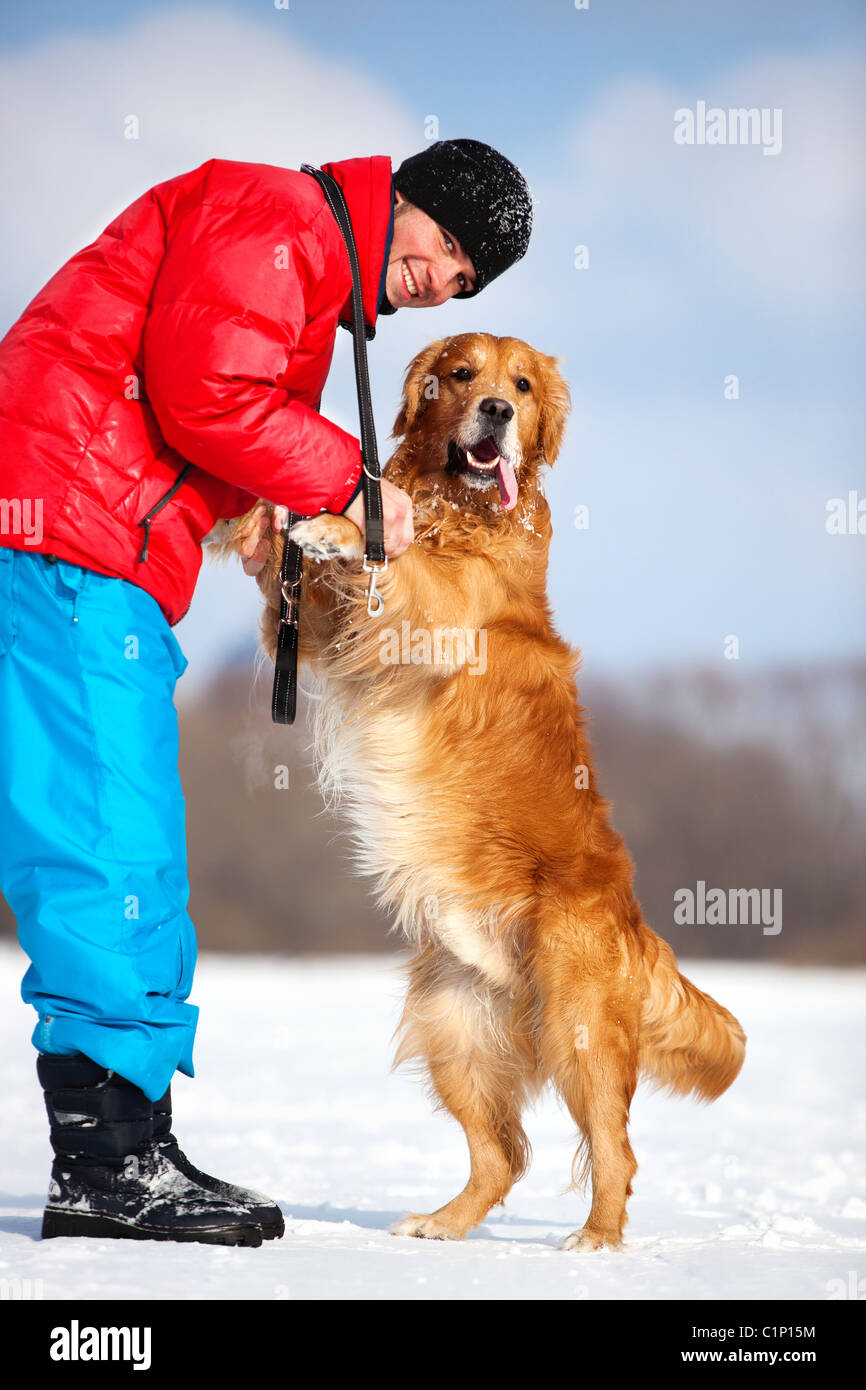 Young man with dog outdoors. - Stock Image