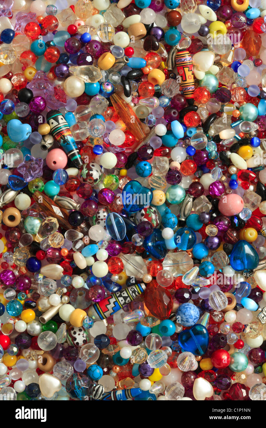 Beads background in assorted colours, shapes and sizes - Stock Image