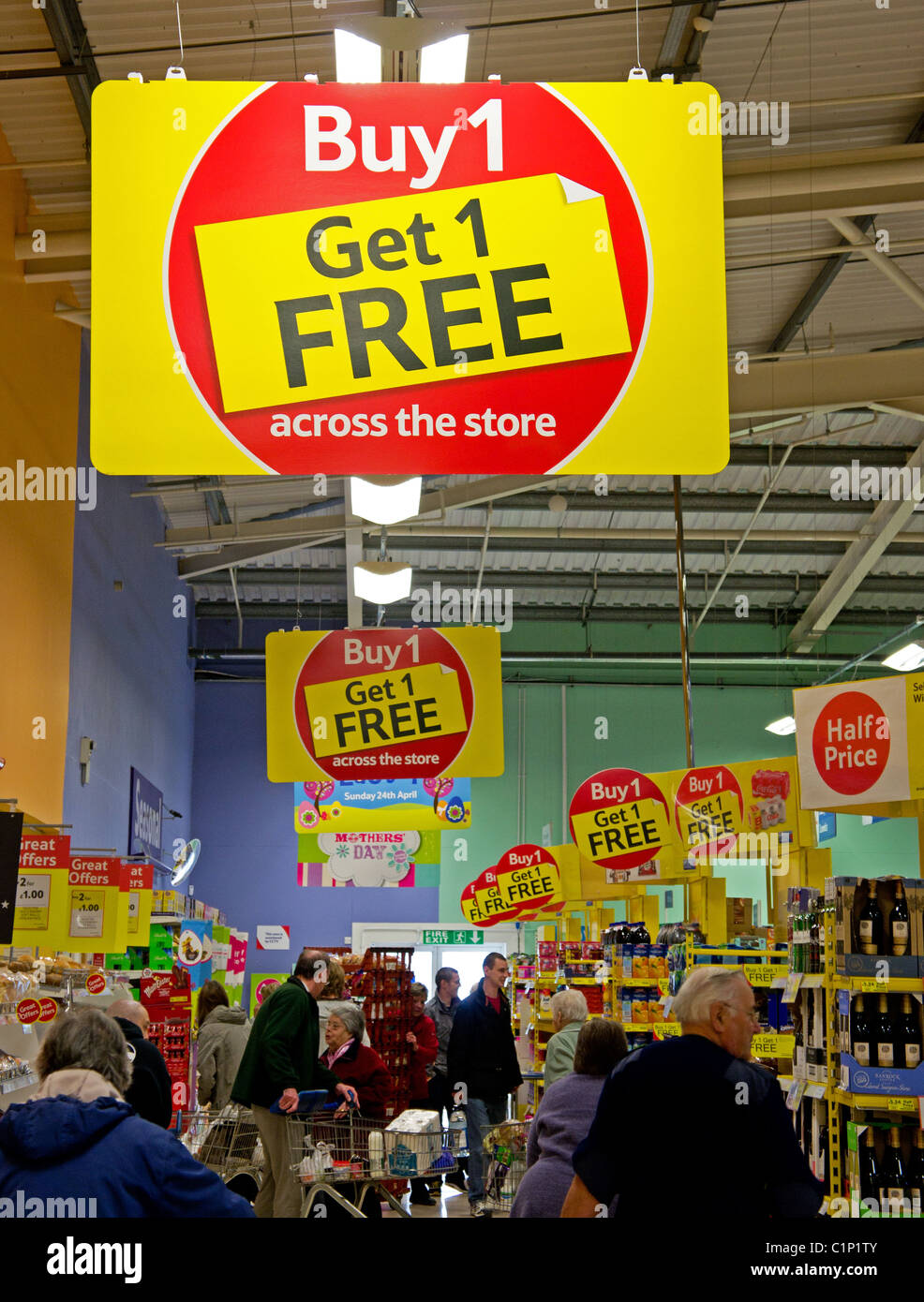 A ' Buy 1 get 1 free ' sign in a Tesco supermarket, UK - Stock Image