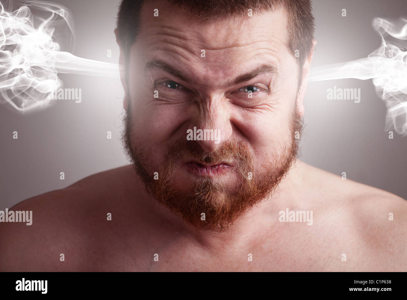 Angry frustrated man with funny stress face expression - Stock Image