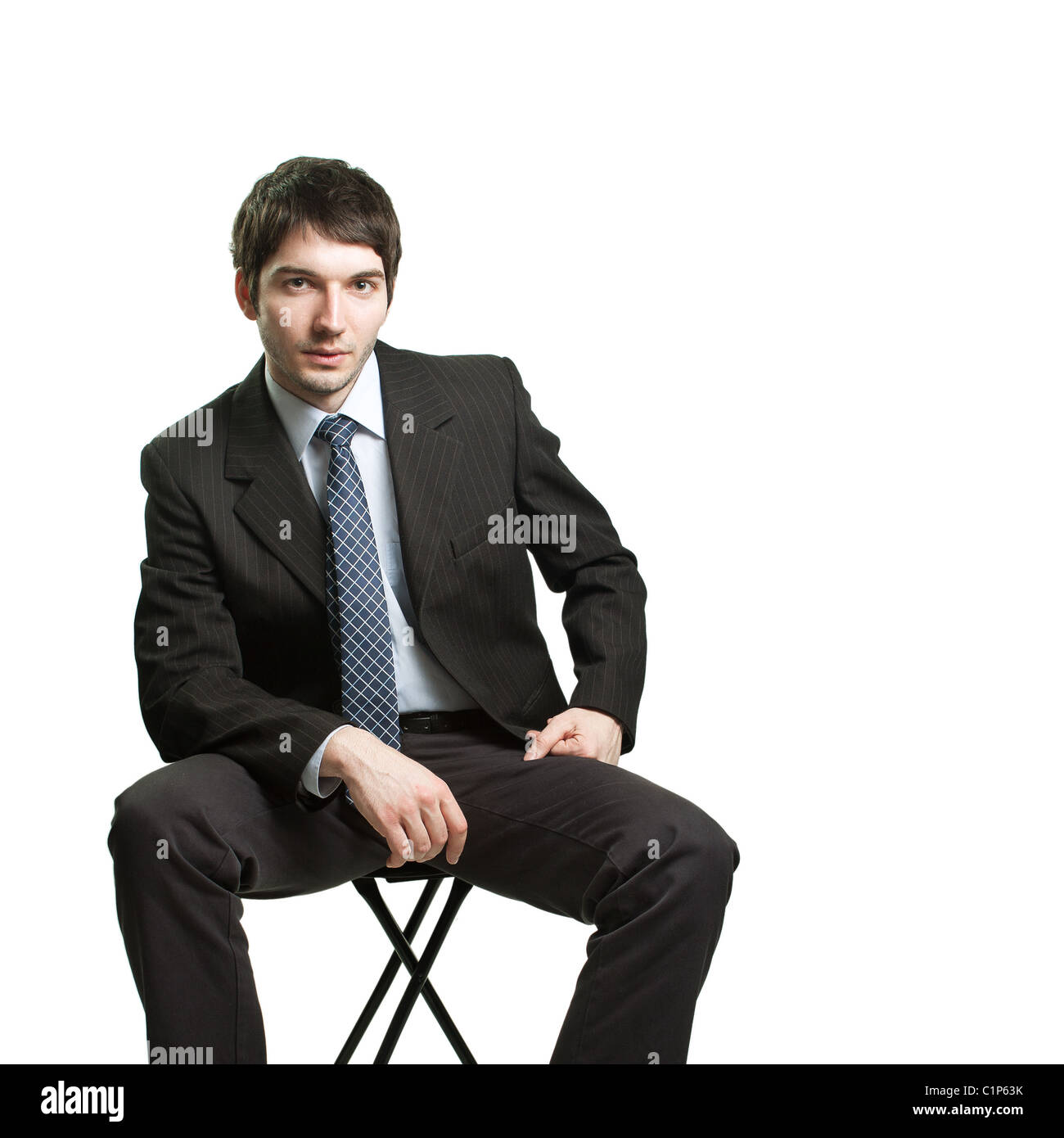 Outstanding Confident Businessman Sitting On Chair Over White Stock Caraccident5 Cool Chair Designs And Ideas Caraccident5Info