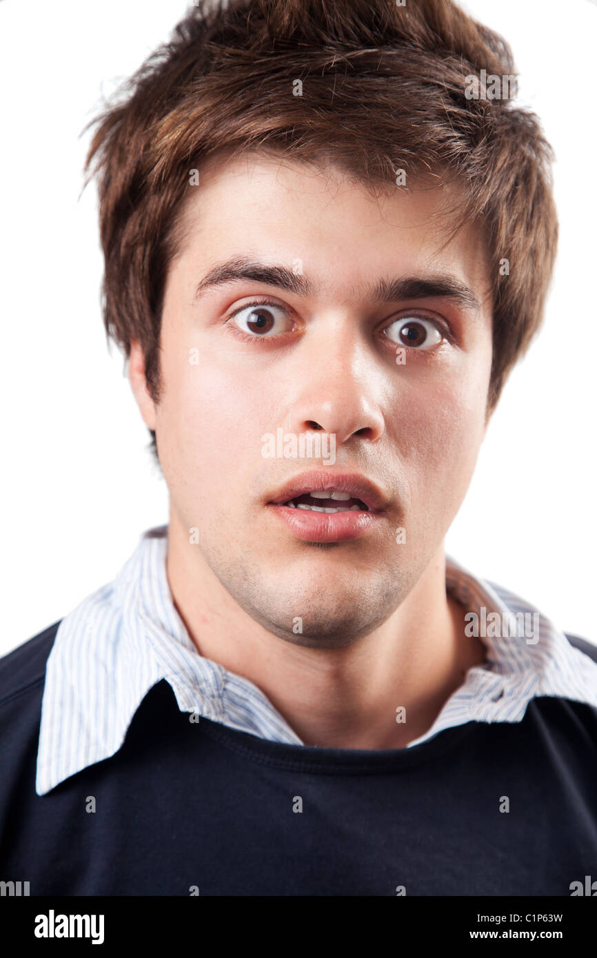 Funny young man beeing amazed and surprised - Stock Image