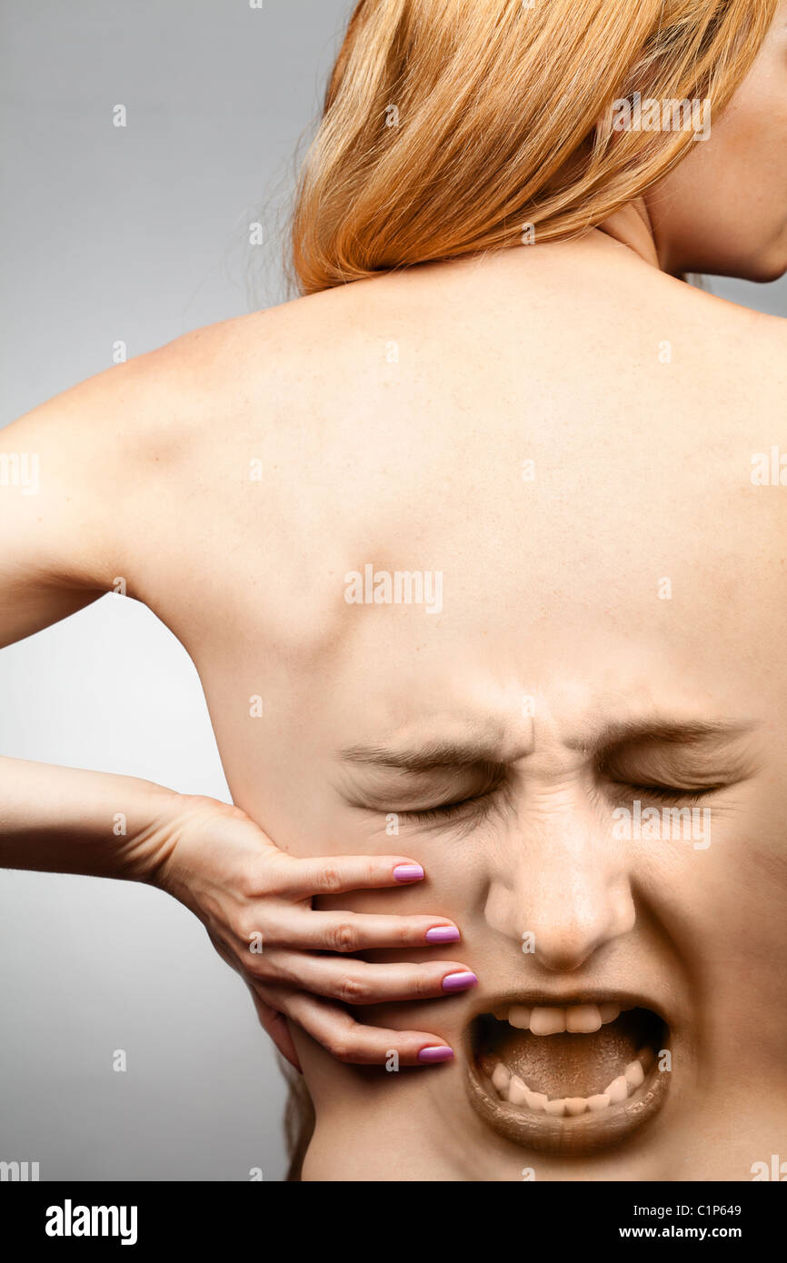 Back pain concept - waist spine in agony - Stock Image