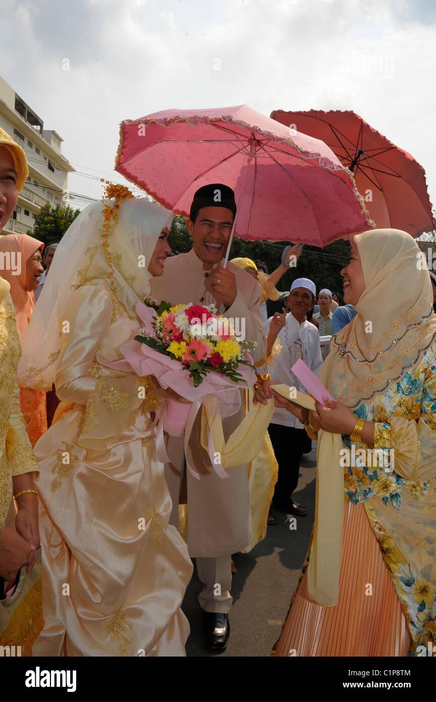 bride and groom and guests , islamic wedding , muslim community , bangkok, thailand - Stock Image