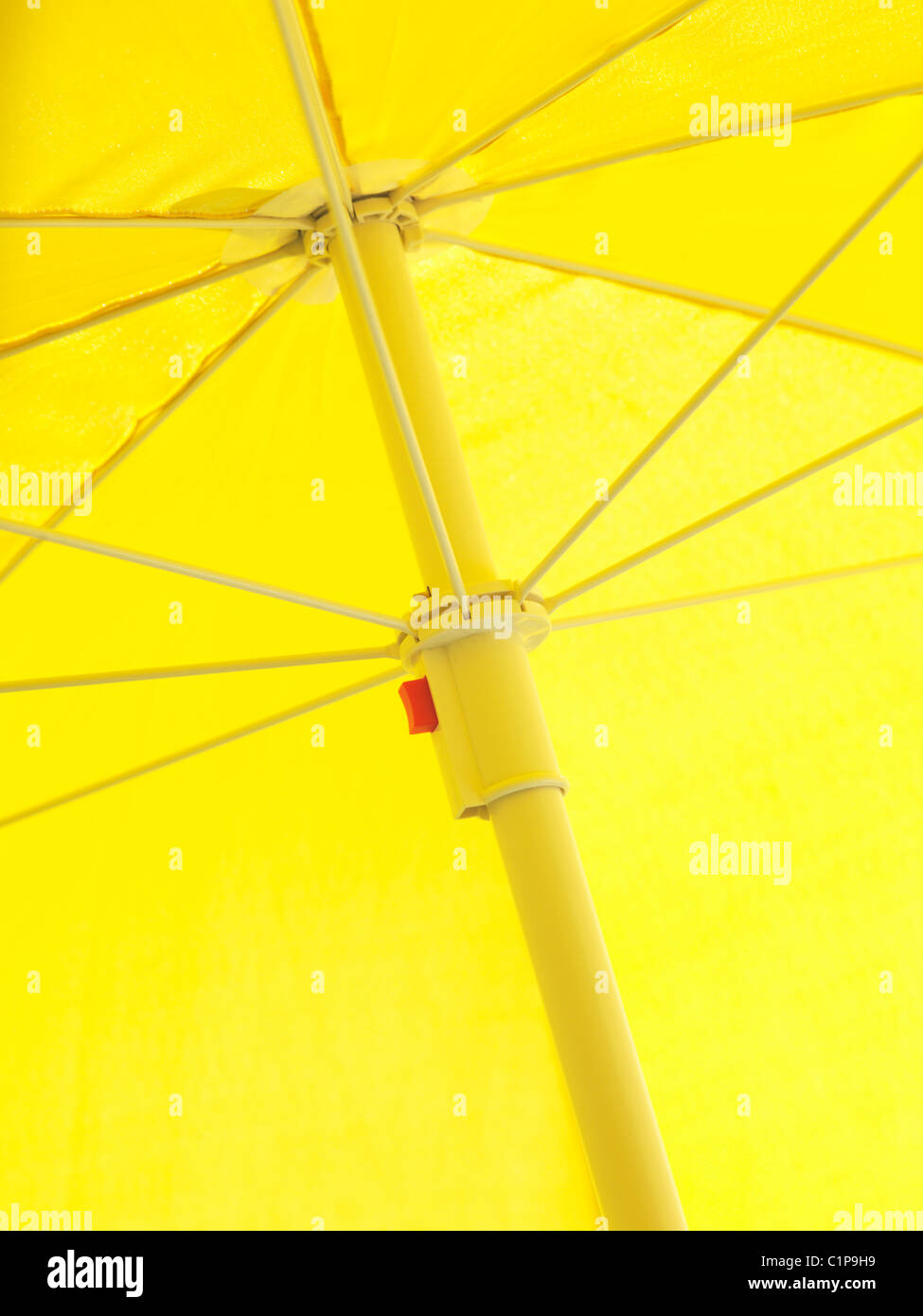 Close-up low-angle view of yellow sunshade - Stock Image