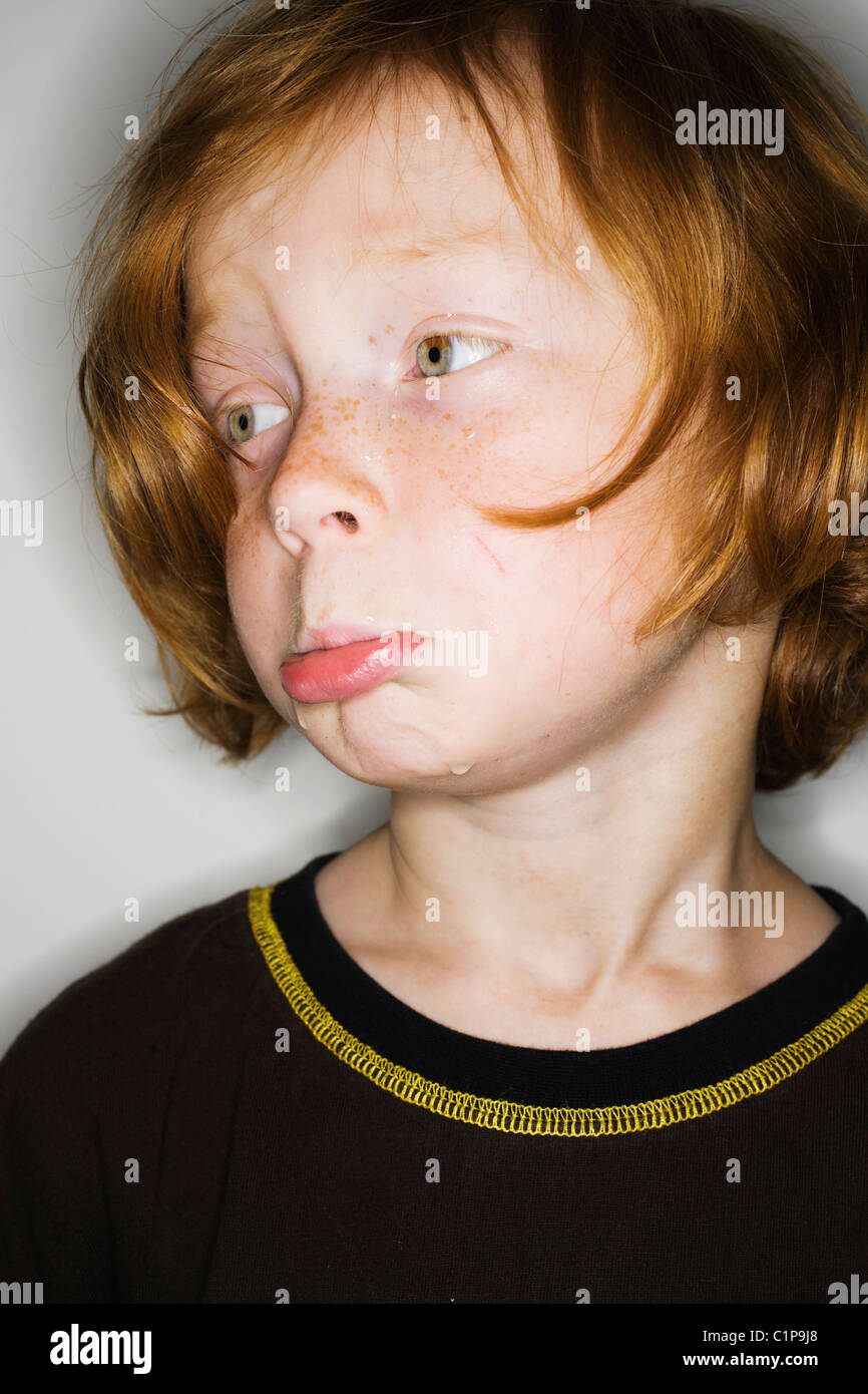 Sad boy looking away - Stock Image