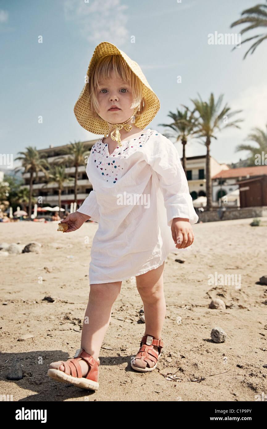 Girl walking on beach - Stock Image
