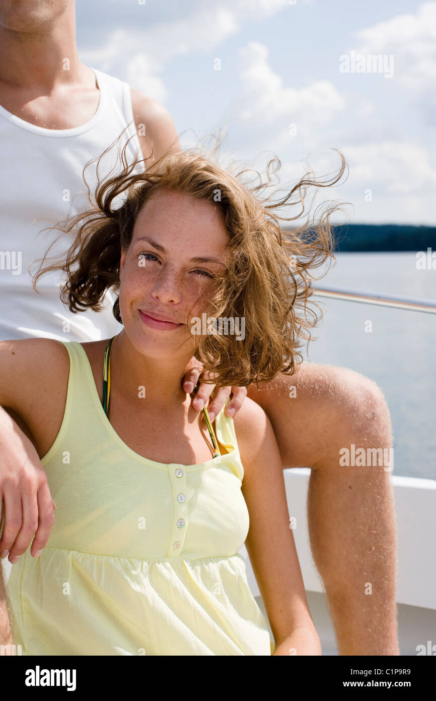 Portrait of woman relaxing in boat on sea Stock Photo