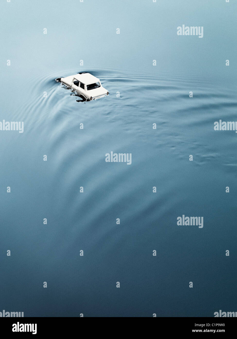 Toy car drowning in water - Stock Image