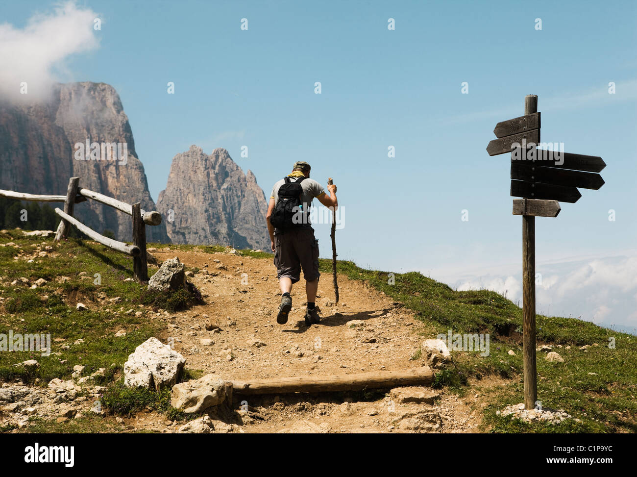 Backpacker on mountain trail - Stock Image