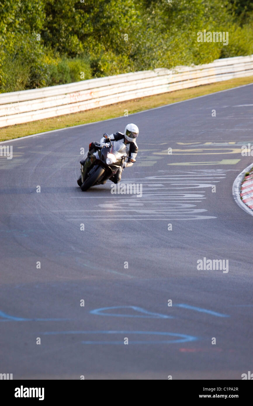 Germany, Nurburgring, Nordschleife, man riding motorcycle on racetrack - Stock Image