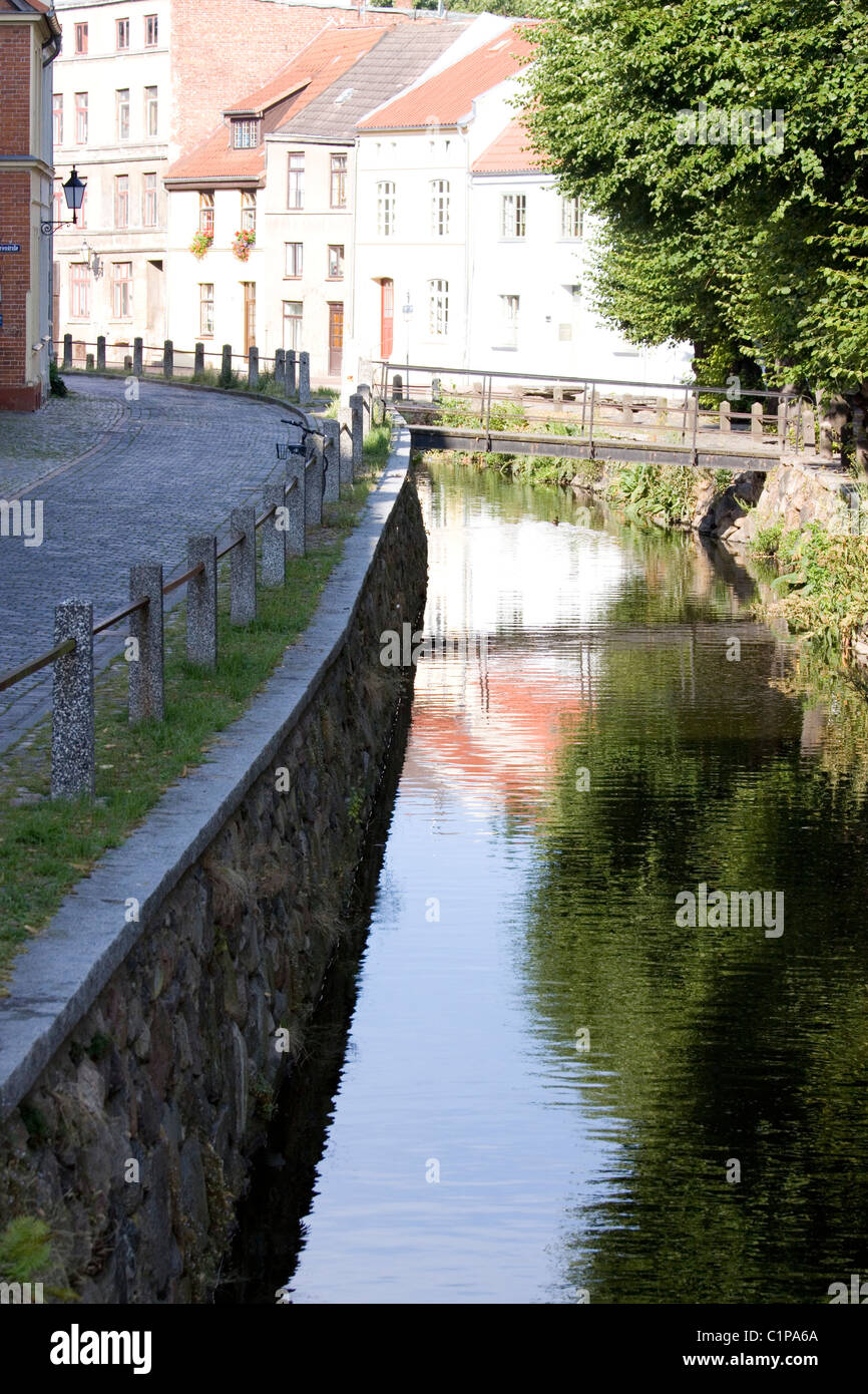 Germany, Wismar, Old Town with bridge over canal - Stock Image