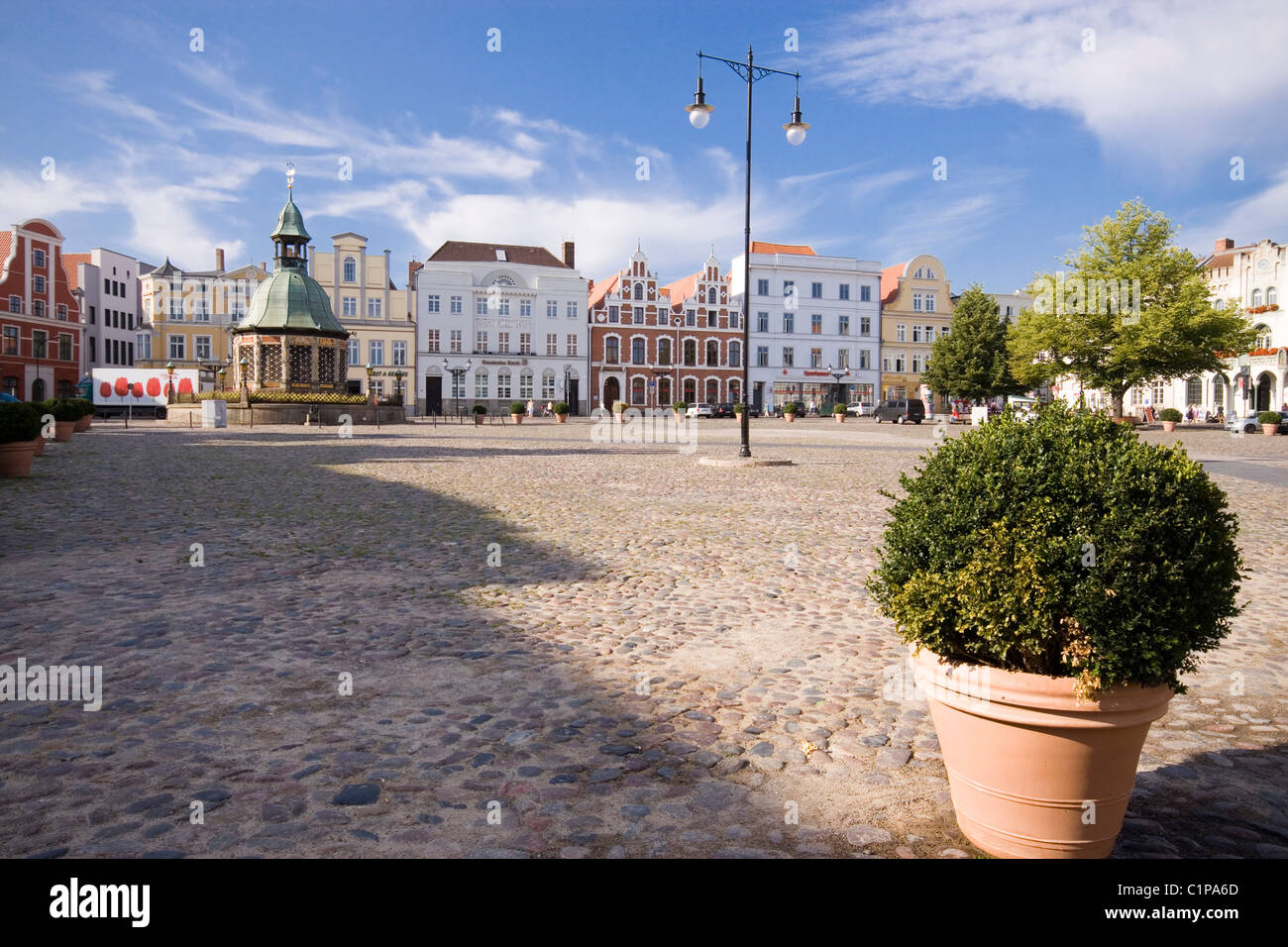 Germany, Wismar, market square with pot plant in foreground - Stock Image