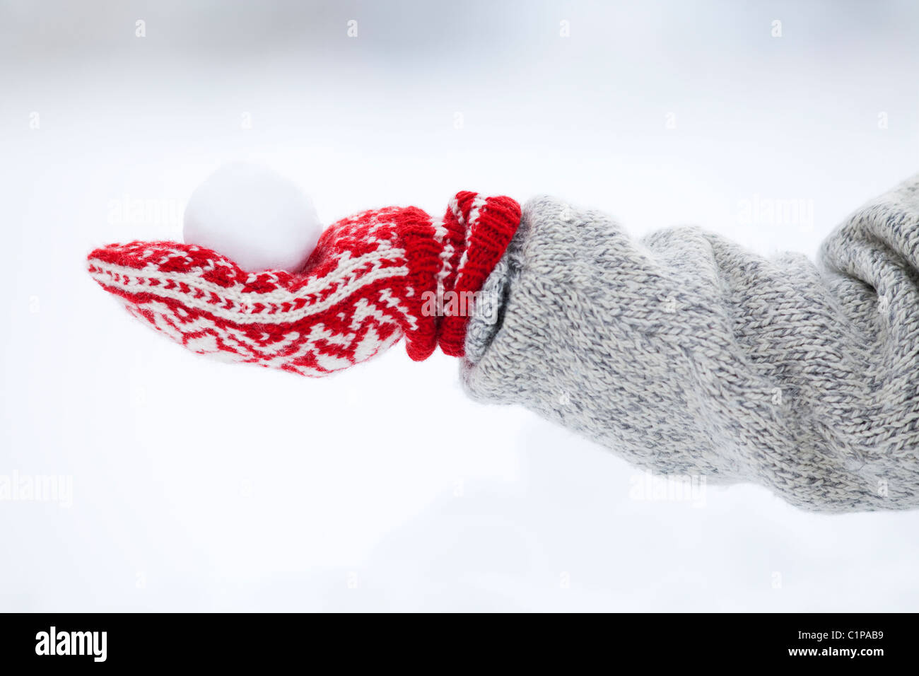 Person holding snowball - Stock Image