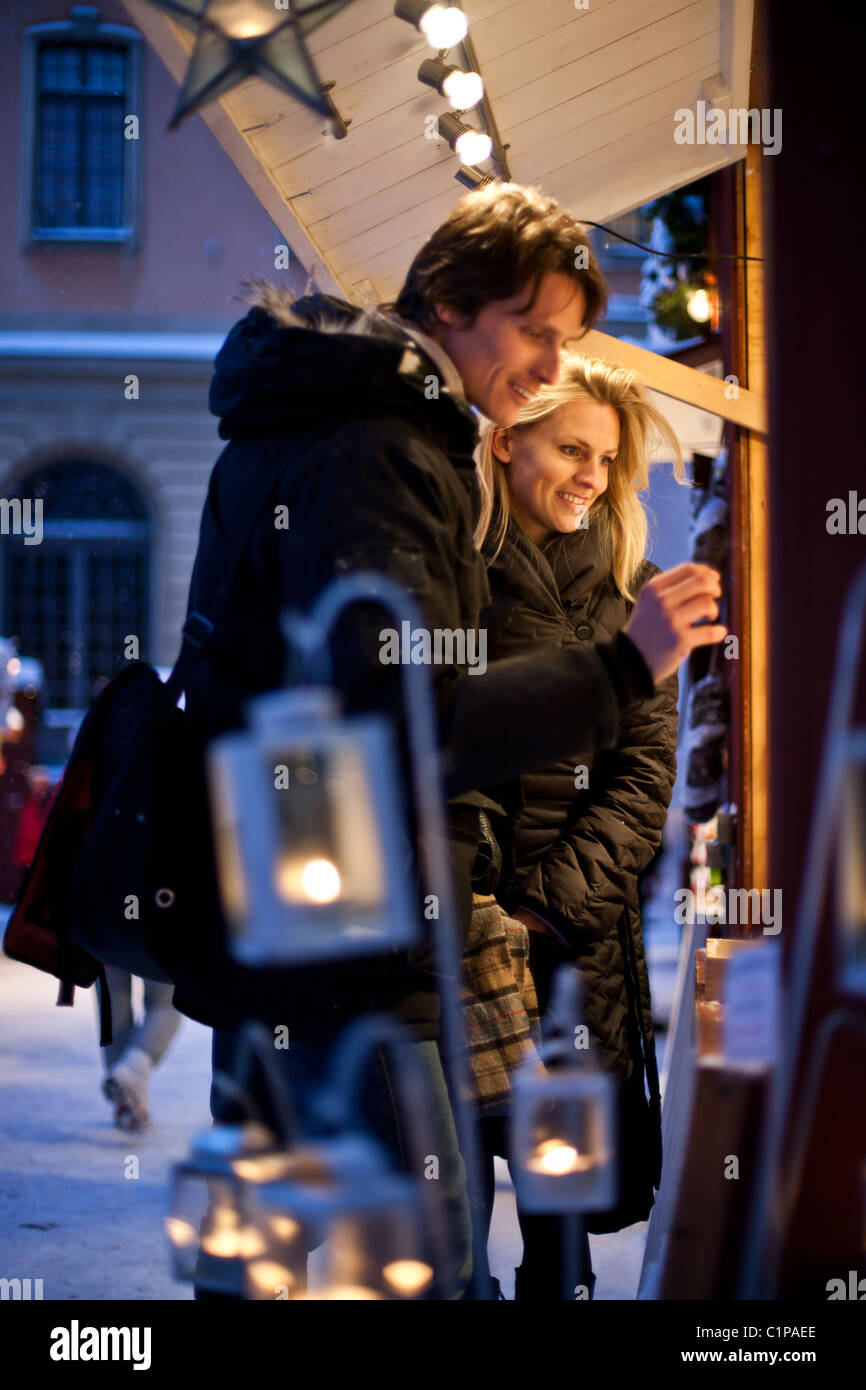 Couple in Christmas market - Stock Image