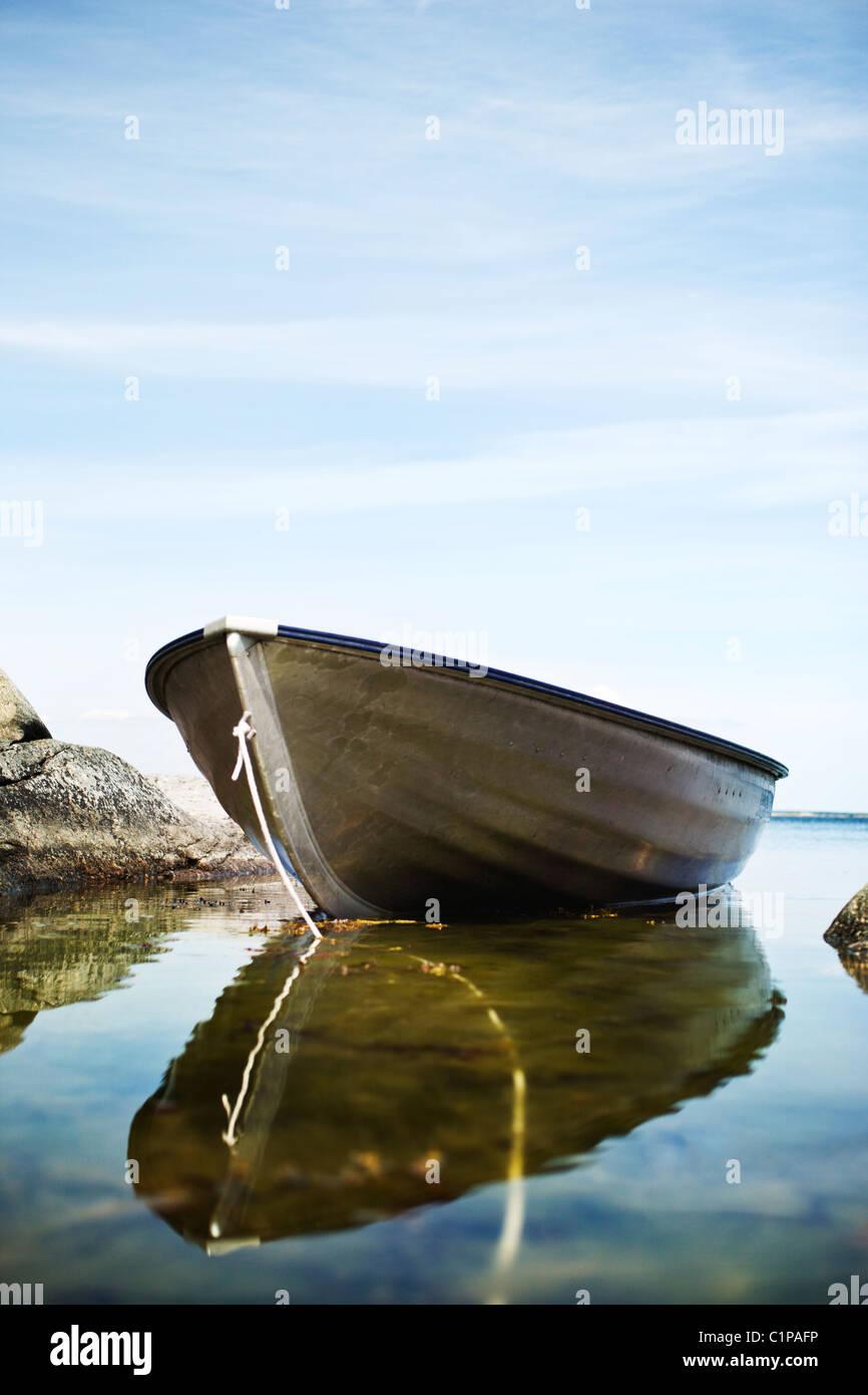 Anchored rowboat - Stock Image