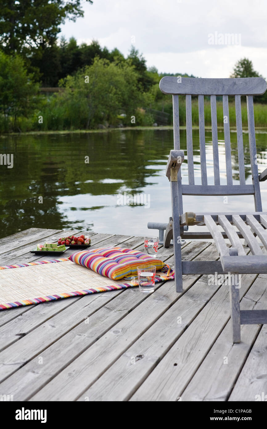 Outdoor chair on jetty - Stock Image