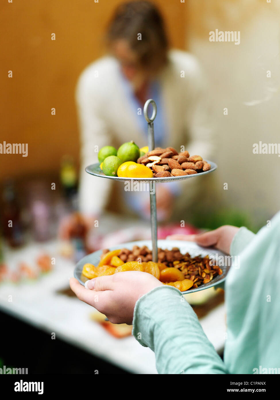Close up of woman serving fruits and nuts Stock Photo