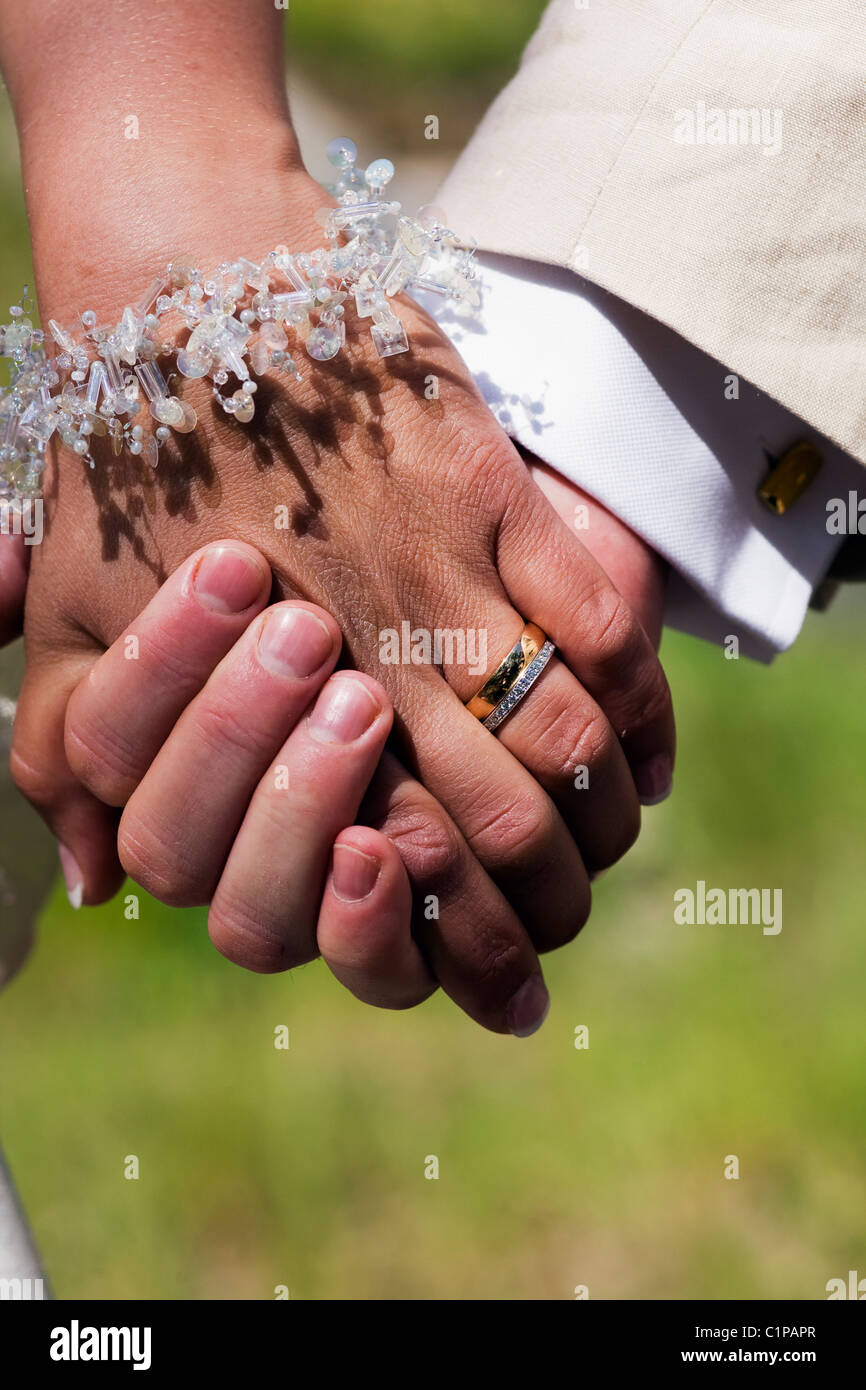 Married couple holding hands - Stock Image