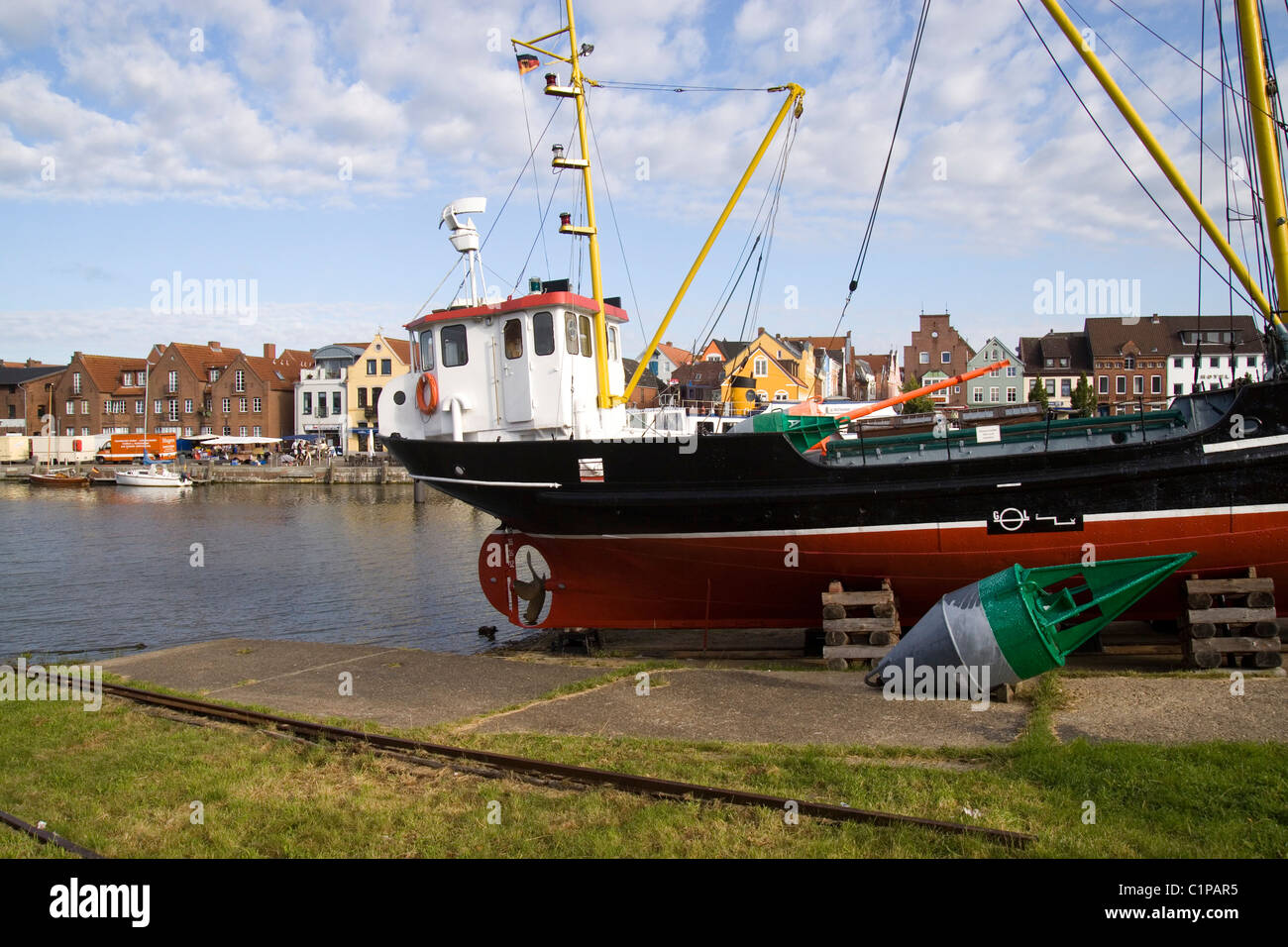 Germany, Husum, fishing boat moored in harbour - Stock Image