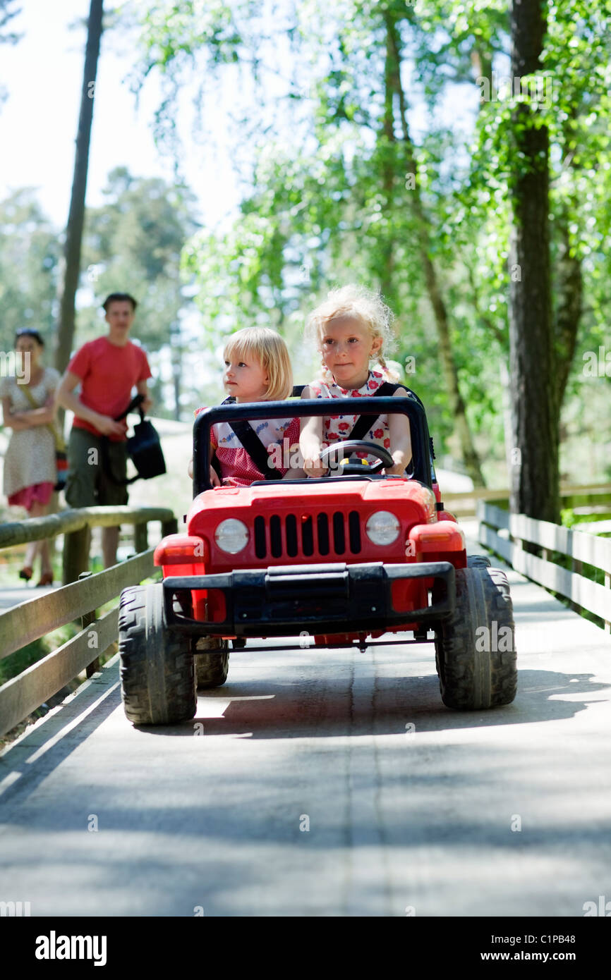 Two  girls in go-cart - Stock Image