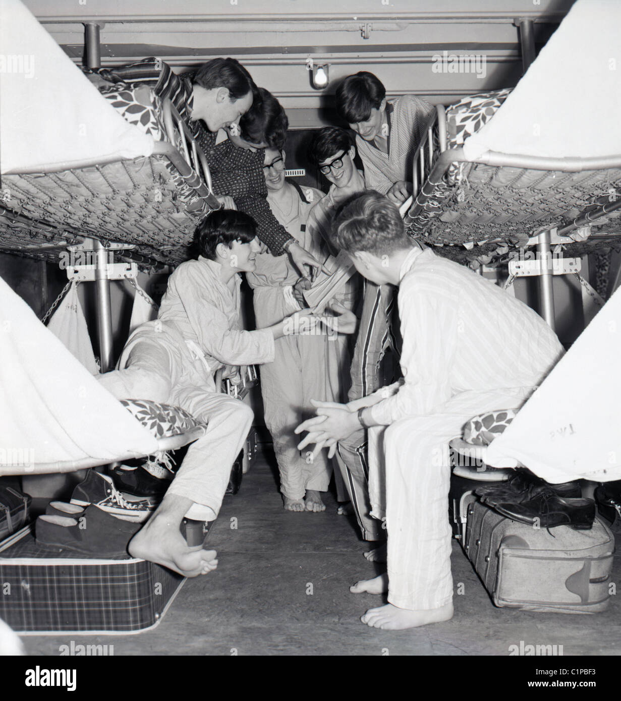 At Sea 1950s Young Adult Boys In Pyjamas On Bunk Beds In Their