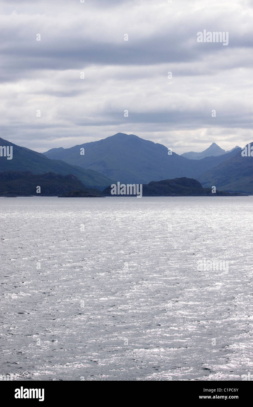 Scotland, Knoydart, sea and mountains with overcast sky above - Stock Image
