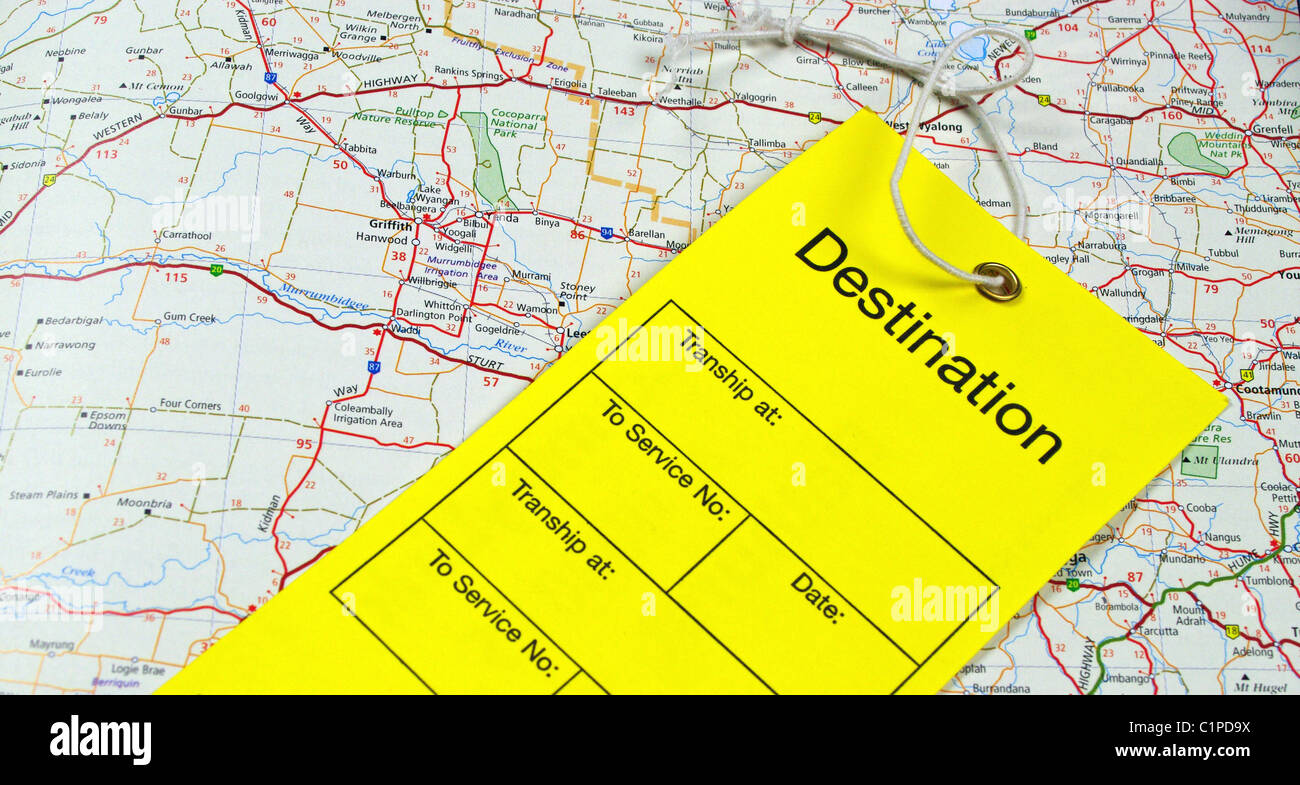 luggage tag on map wording destination colour yellow - Stock Image