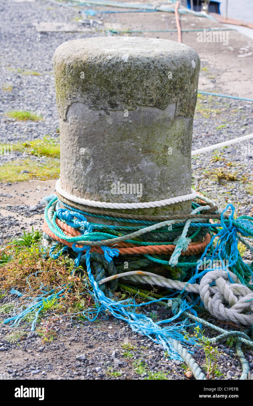 Republic of Ireland, County Sligo, Mullaghmore, concrete mooring post - Stock Image