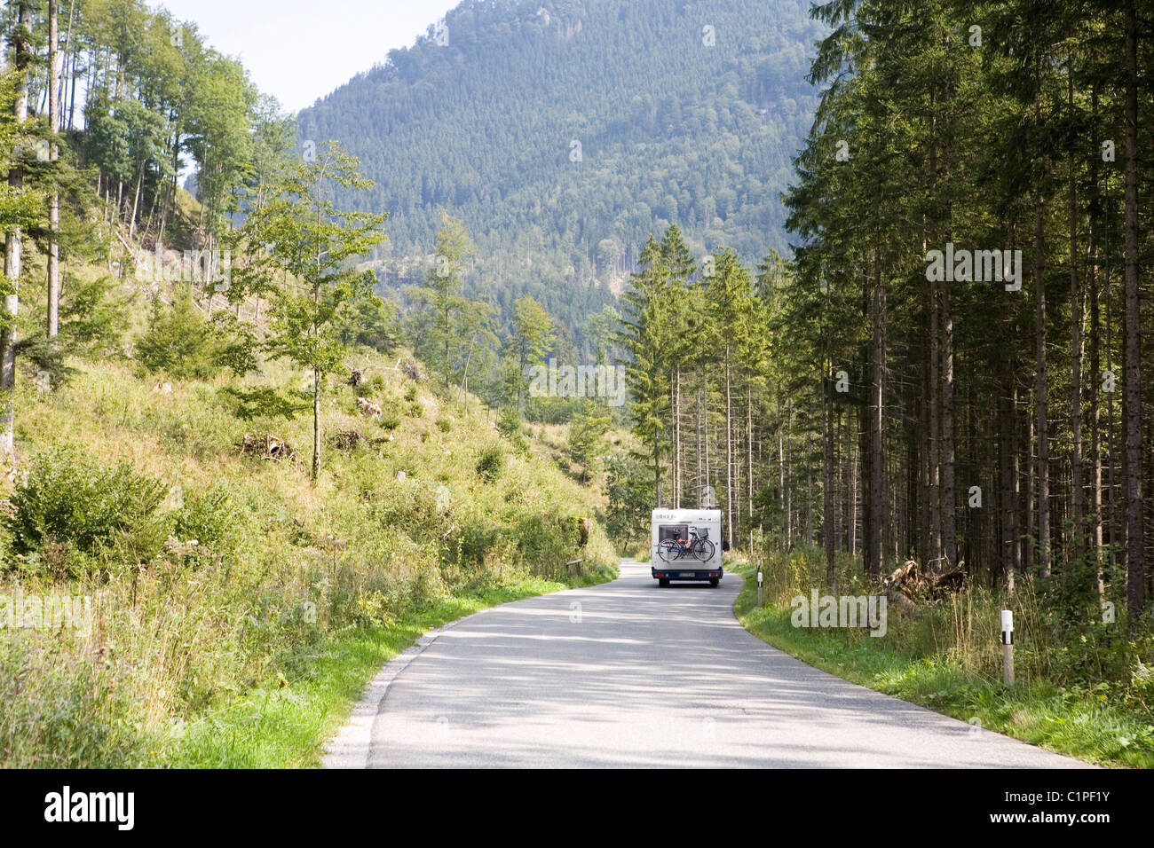 Germany, Bavaria, Bayrischzell, motorhome on road - Stock Image