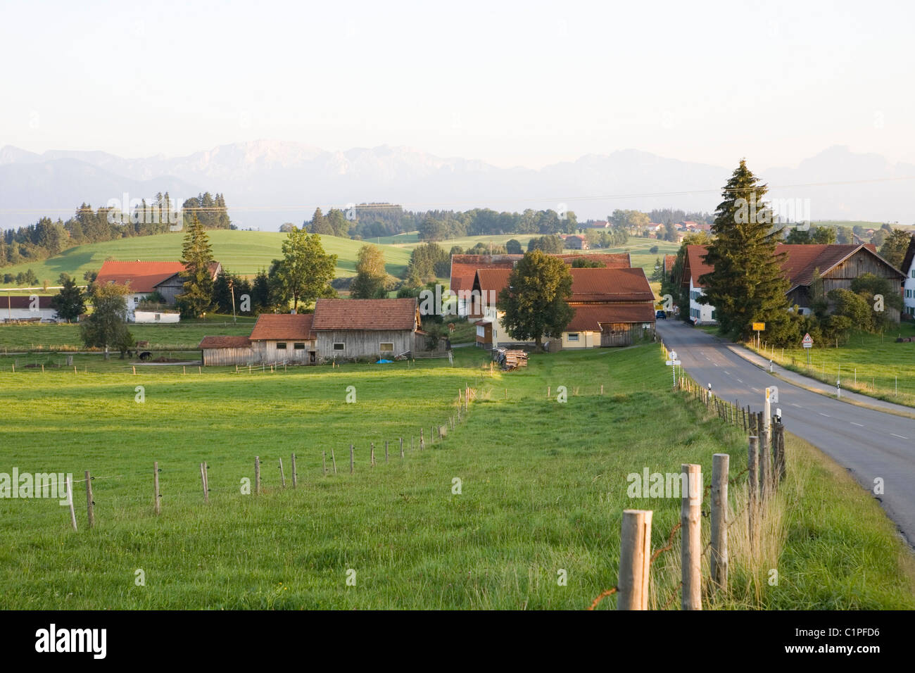 Germany, Bavaria, village with fields and country road - Stock Image
