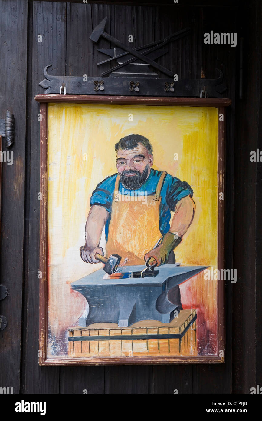 Germany, Bavaria, painted sign of blacksmith at forge - Stock Image