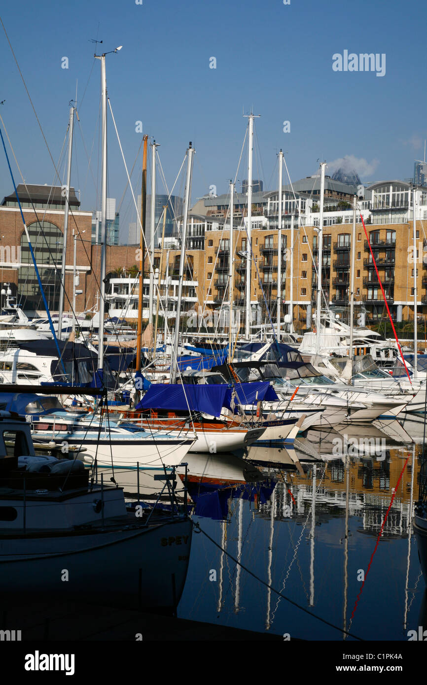Yachts moored in St Katharine's Dock, Wapping, London, UK - Stock Image