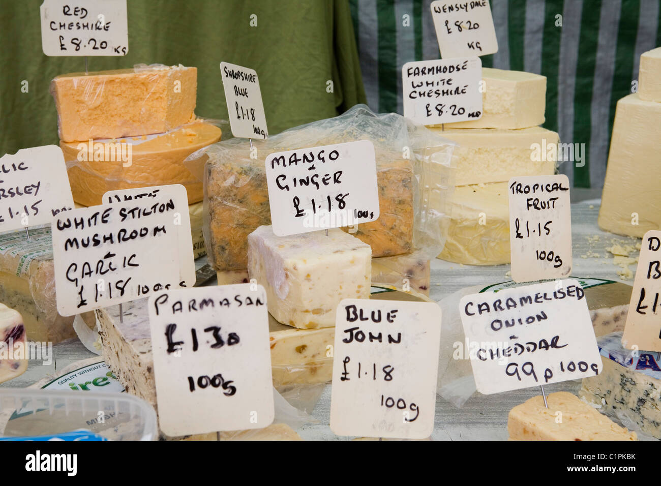 UK, Derbyshire, Bakewell, locally produced cheese on market stall - Stock Image