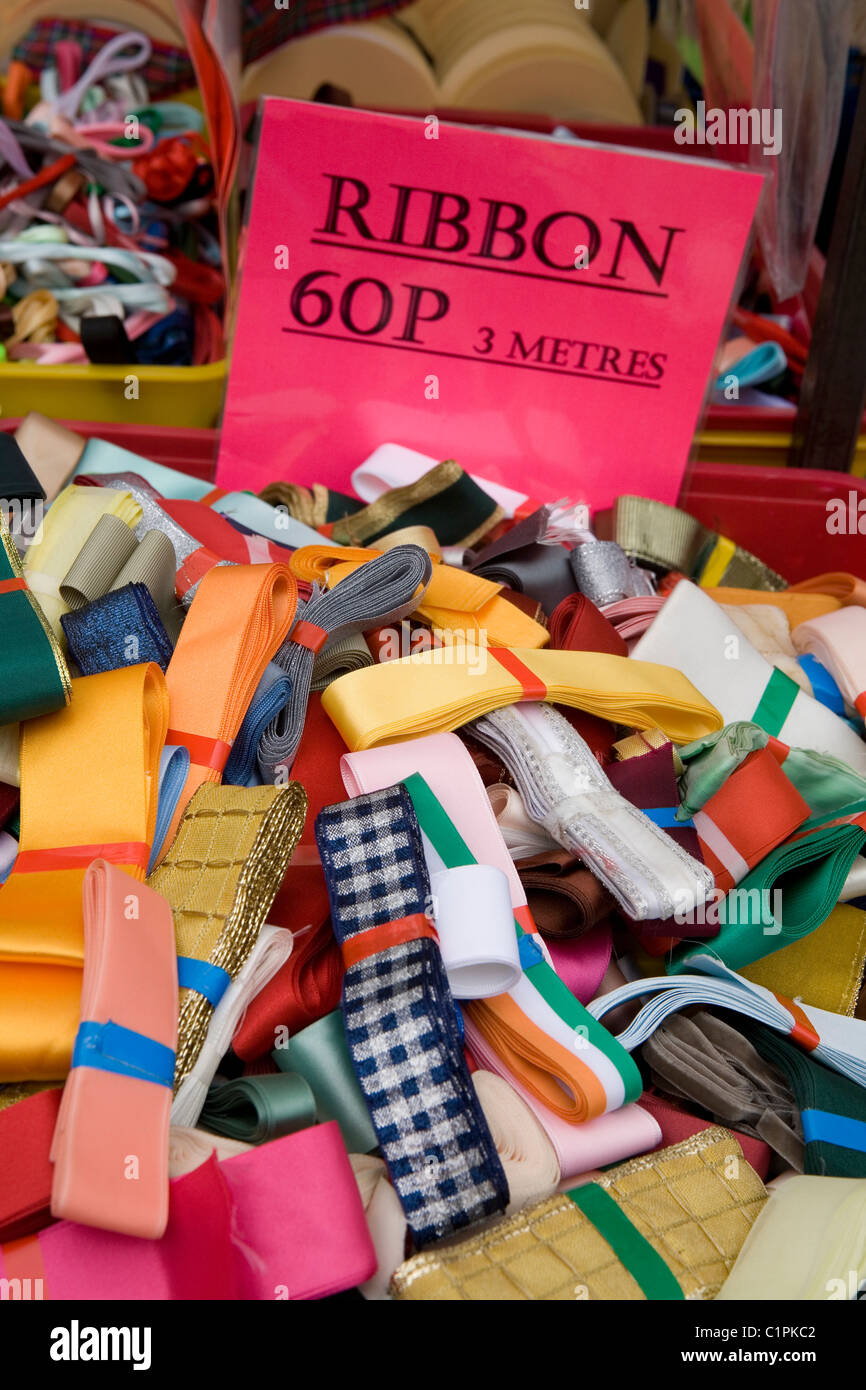 England, Derbyshire, Bakewell, ribbons for sale on market stall - Stock Image
