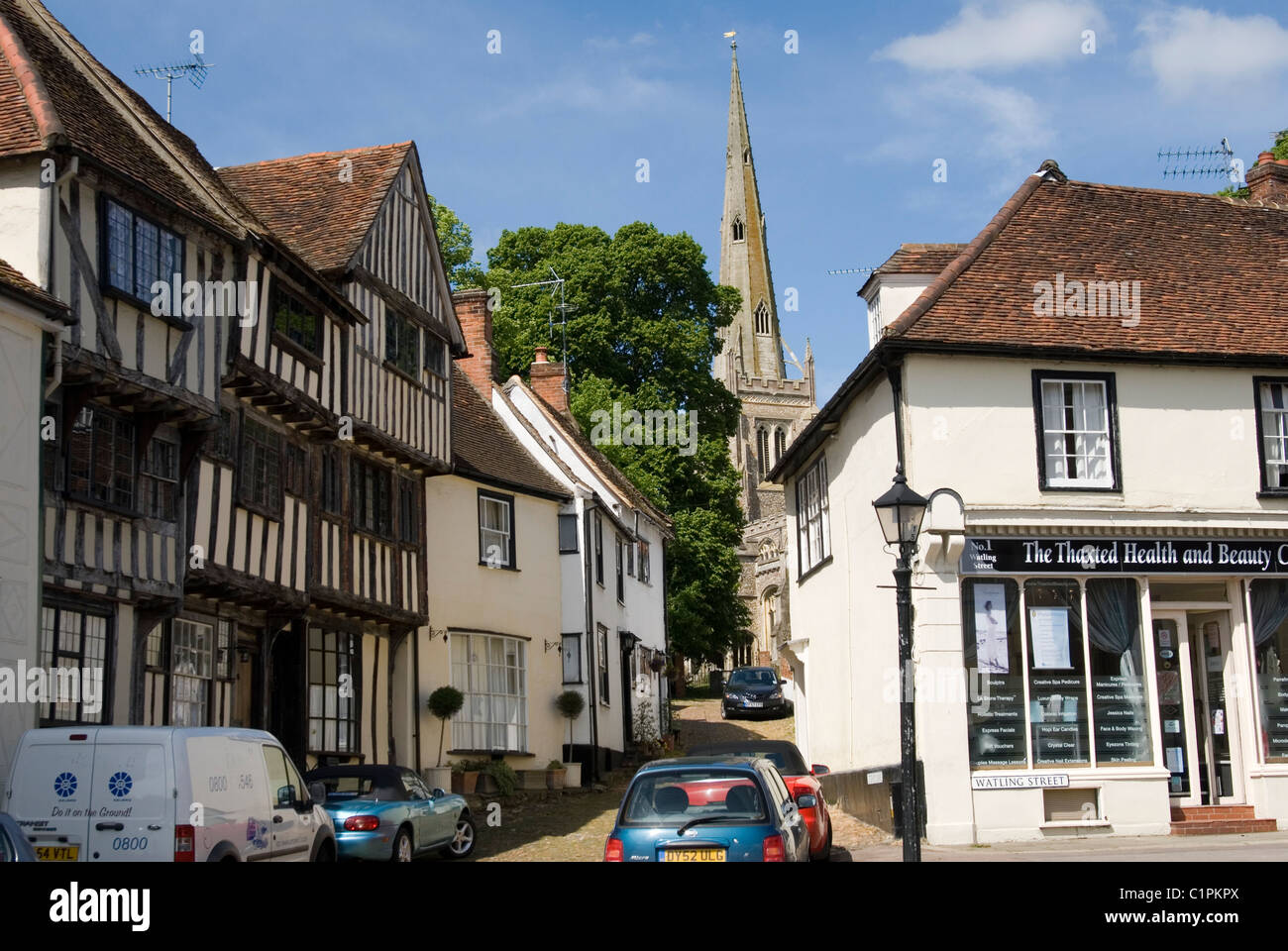 England, Thaxted, half-timbered building and church spire - Stock Image