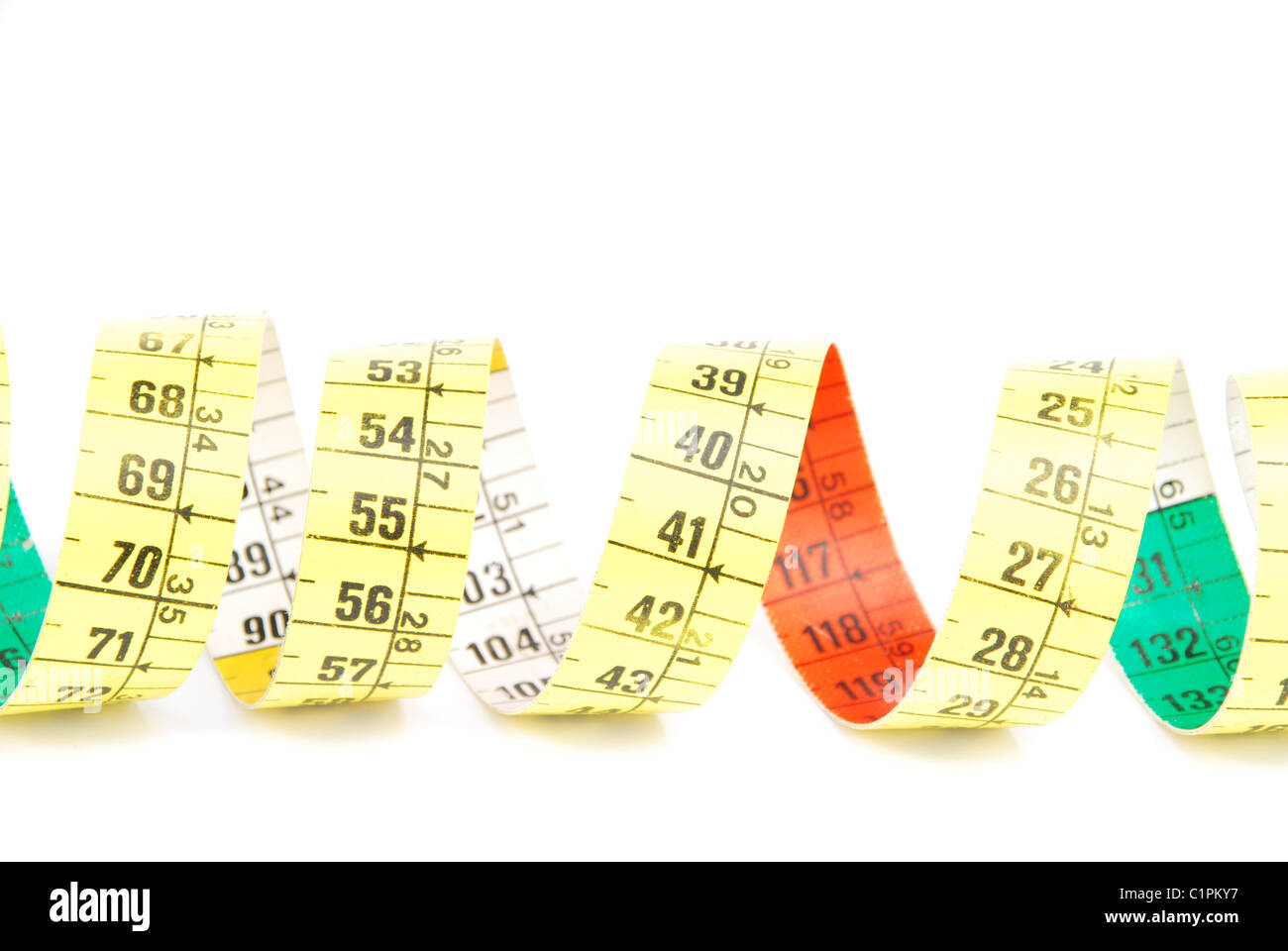 Curled measuring tape on white - Stock Image